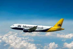 Monarch airlines aircraft flying over the clouds